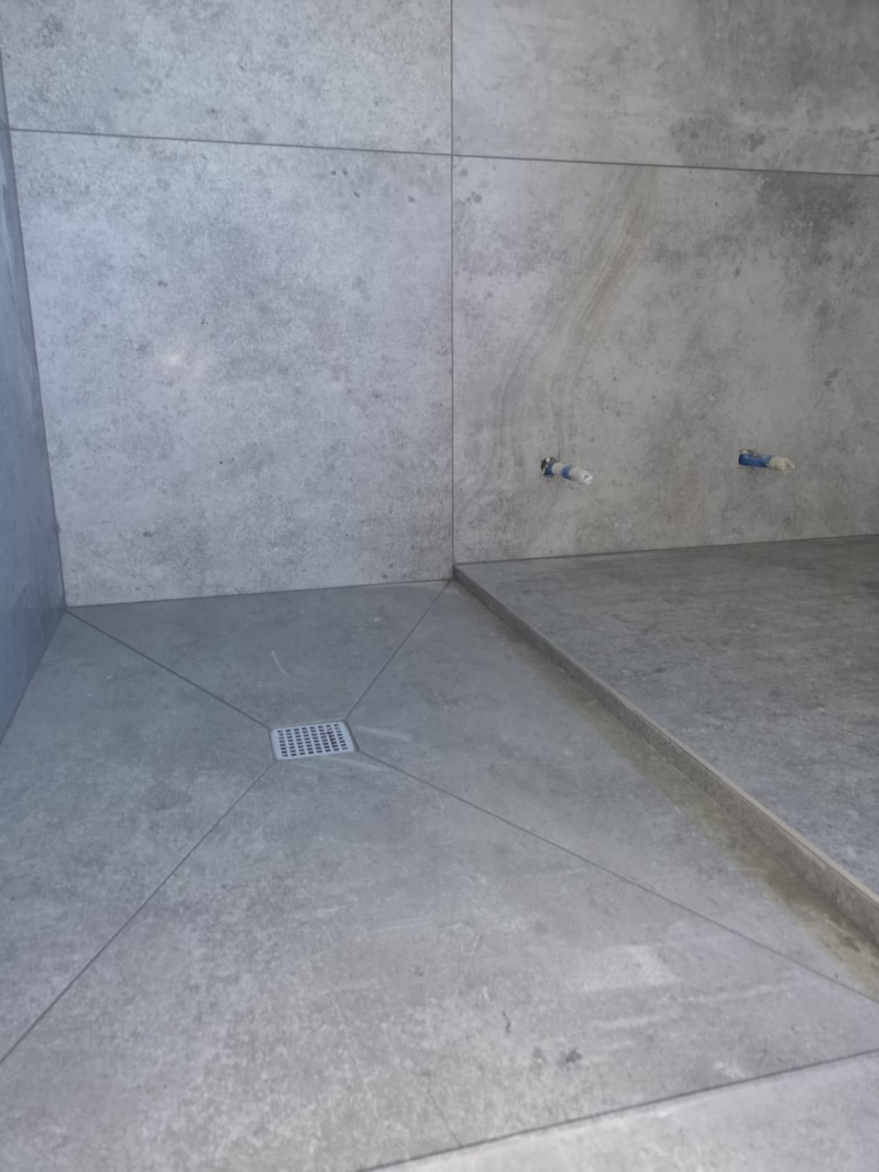 Piatto doccia in piastrelle come realizzarlo fratelli pellizzari - Posare un piatto doccia ...
