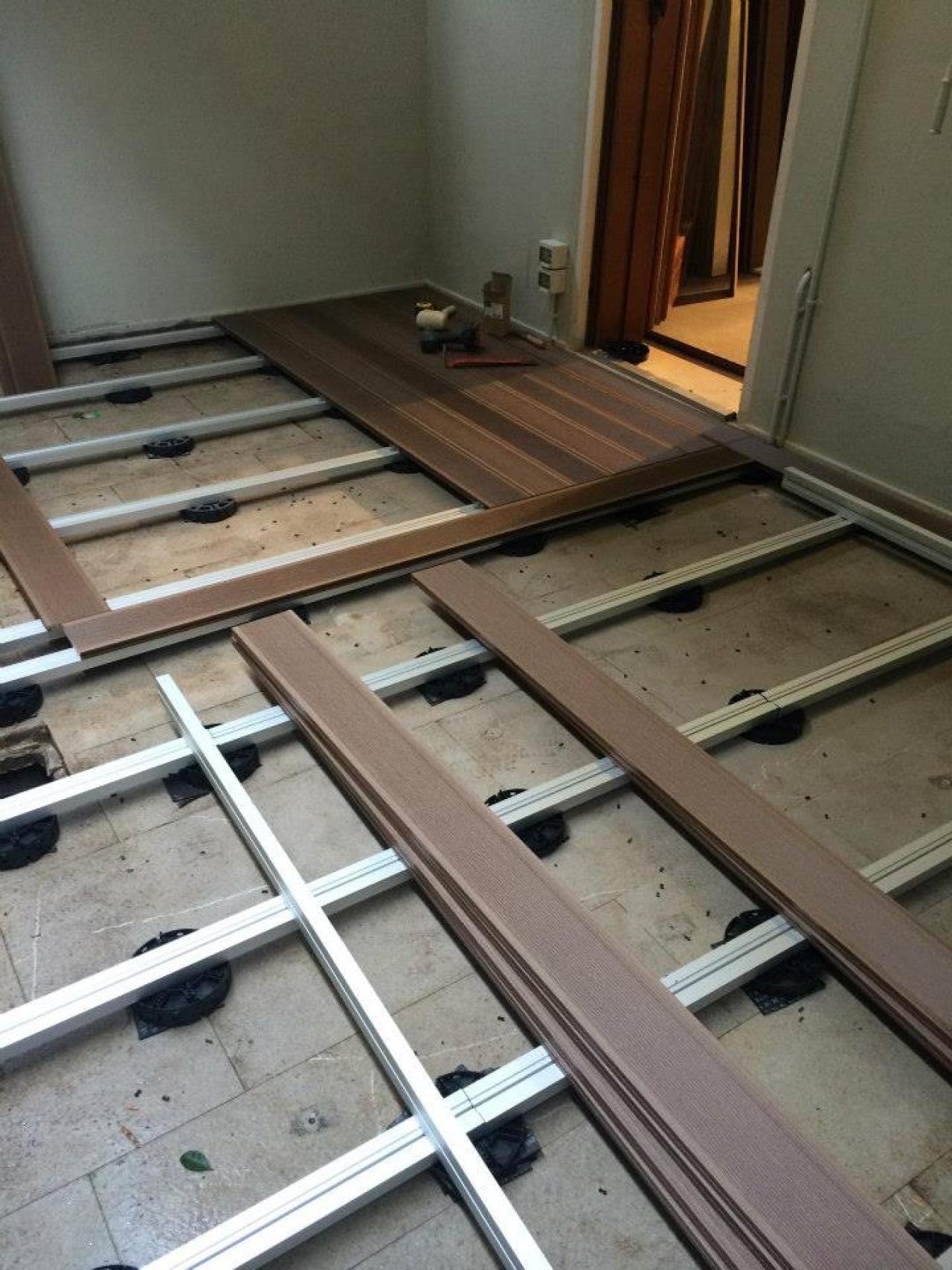 Pavimenti in legno per esterno a vicenza e a verona - Piastrelle sopra piastrelle ...